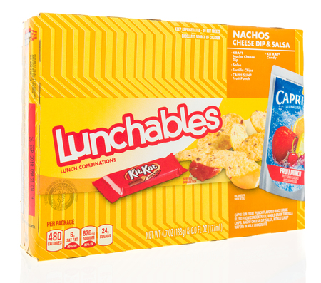 Winneconne, WI - 9 September 2018: A package of Lunchables with Kraft cheese, Capri Sun drink and a KitKat candy bar on an isolated background Sajtókép