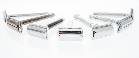 A collection of different kink of safety razors on an isolated background Stock Photo