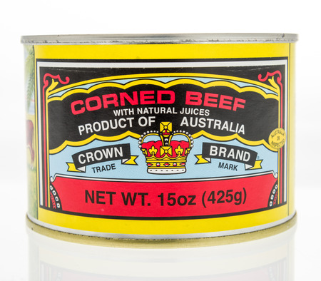 Winneconne, WI - 7 October 2018: A can of Crown Brand corned beef on an isolated background