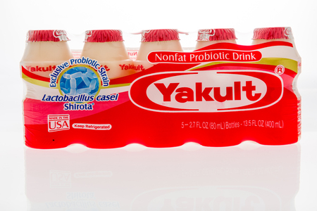 Winneconne, WI - 10 October 2018: A package of  Yakult nonfat probiotic drink on an isolated background