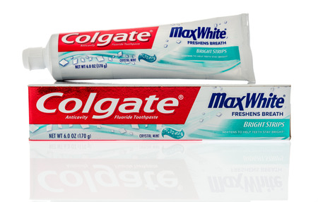 Winneconne, WI - 9 October 2018:  A package of Colgate Max white toothpaste on an isolated background.