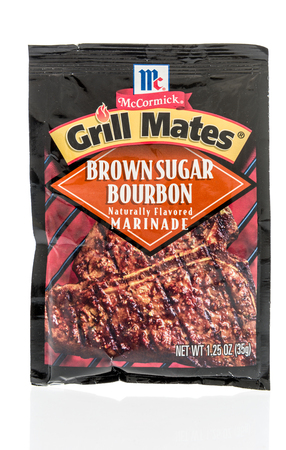 Winneconne, WI - 9 October 2018: A package of McCormick grill mates in brown sugar bourbon flavor marinade on an isolated background. Editorial