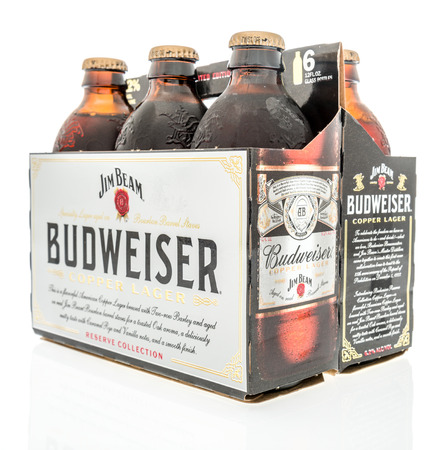 Winneconne, WI - 19 October 2018: A six pack of  Budweiser reserve copper lager with Jim Beam beer  on an isolated background