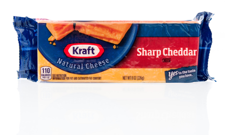 Winneconne, WI - 21 November 2018: A package of Kraft sharp cheddar cheese on an isolated background.