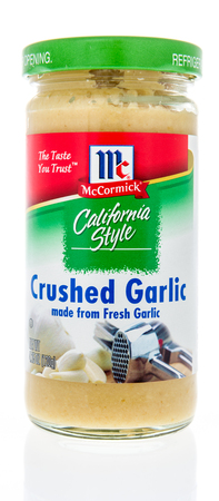 Winneconne, WI - 21 February 2019: A package of McCormick California style crushed garlic on an isolated background