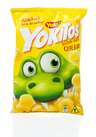 Winneconne, WI - 3 March 2019: A package of Yoki Yokitos Bolinhas queijo chips on an isolated background