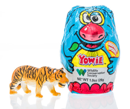 Winneconne, WI - 10 March 2019: A package Yowie chocolate egg with surprise inside with a Siberian Tiger on an isolated background Editorial