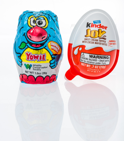 Winneconne, WI - 10 March 2019: A package Yowie chocolate egg and Kinder joy egg both of which have surprise inside on an isolated background