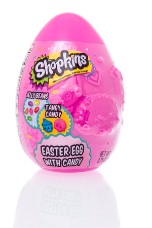 Winneconne, WI - 10 March 2019: A package Shopkins Easter Egg with candy including jelly beans and tangy candy on an isolated background