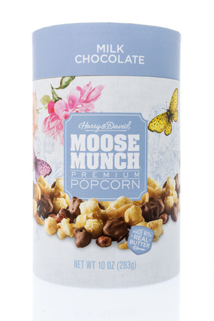 Winneconne, WI - 26 March 2019: A package of Harry and David moose munch milk chocolate popcorn on an isolated background