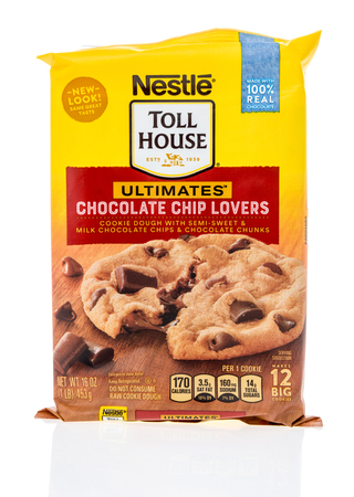 Winneconne, WI - 24 March 2019: A package of  Neslte Toll House ultimates chocolate chip lovers cookie dough with semi-sweet and milk chocolate chips and chocolate chunks dough on an isolated background