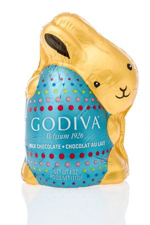 Winneconne, WI - 26 March 2019: A package of  Godiva belgium milk chocolate bunny on an isolated background