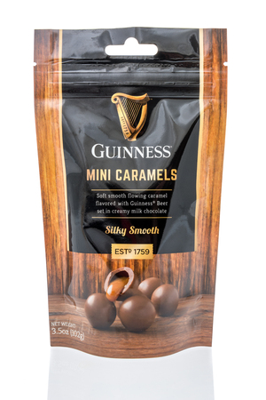 Winneconne, WI - 24 March 2019: A package of  Guinness mini caramels creamy milk chocolate on an isolated background