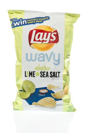 Winneconne, WI -  12 April 2019: A bag of Lays wavy electric lime and sea salt chips on an isolated background