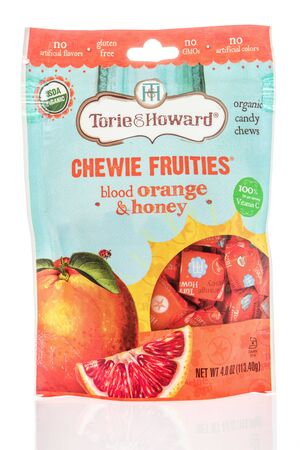 Winneconne, WI -  19 April 2019: A package of Torie and Howard chewie blood orange and honey organic candy chews on an isolated background Editorial