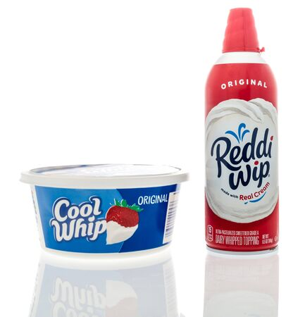 Winneconne, WI - 26 November 2019: A package of JCool whip and reddi wip cream toppings on an isolated background