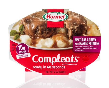 Winneconne, WI - 14 January 2019 : A package of Hormel compleats meatloaf and gravy with mashed potatoes on an isolated background 報道画像