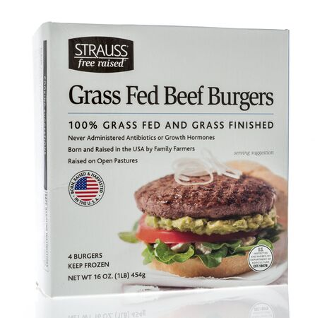 Winneconne, WI - 19 January 2019 : A package of Strauss free raised grass fed beef burgers on an isolated background 報道画像