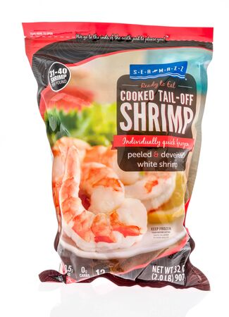 Winneconne,  WI - 11 February 2020:  A package of Sea Mazz cooked tail off shrimp on an isolated background.