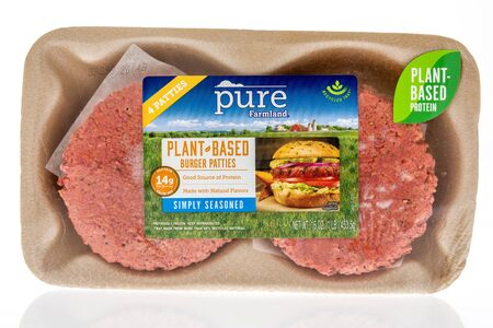 Winneconne,  WI - 11 February 2020:  A package of Pure Farmland vegan burgers on an isolated background.