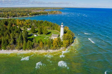 The famous Cana Island lighthouse located next to lake Michigan in Door County Wisconsin with a drone. Фото со стока