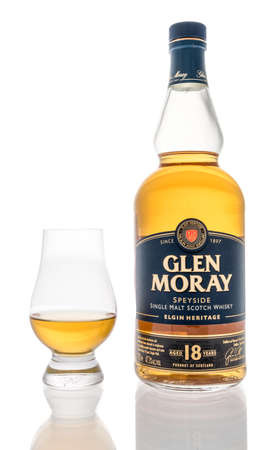 Winneconne, WI -22 January 2021: A bottle of Glen Moray speyside single malt scotch whishy with a glencairn glass on an isolated background.