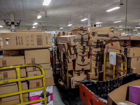 Oshkosh, WI - 14 June 2020:  Amazon packages loaded up on pipe trucks at either UPS amazon delivery, FedEx amazon delivery, United States Postal Service Amazon Delivery.