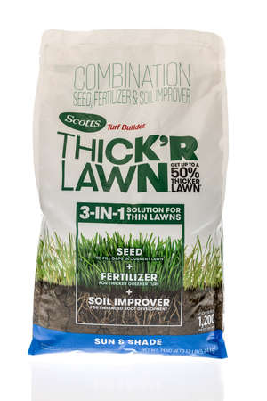 Winneconne, WI - 27 April 2021: A package of Scotts thick r lawn seed, fertilizer and soil improver on an isolated background