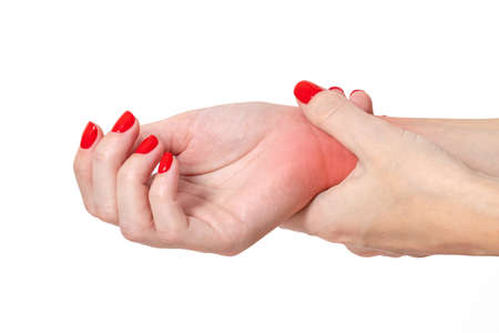 Close up Woman holding her wrist, pain concept.