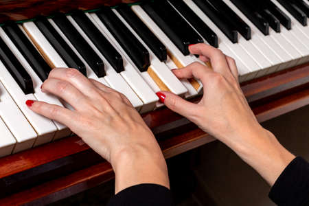 Female hands of a piano player.