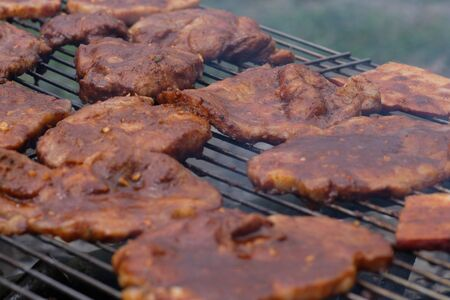 Grilled meat on the barbecue. Food background selective focus.