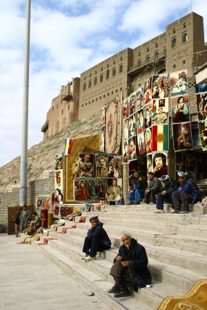 Arbil, Iraq - January 30, 2007: Gift shop in closest of Erbil castle, Iraq. Kurdish flags and portraits of Molla Mustafa Barzani, Kurdish president and leader of KD