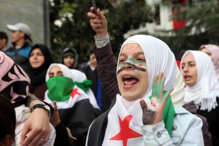 al assad: ISTANBUL,TURKEY-DECEMBER 2  Syrians living in Istanbul protest the regime of Bashar Essad in front of Syrian Consulate on December 2, 2011 in Istanbul,Turkey  Editorial