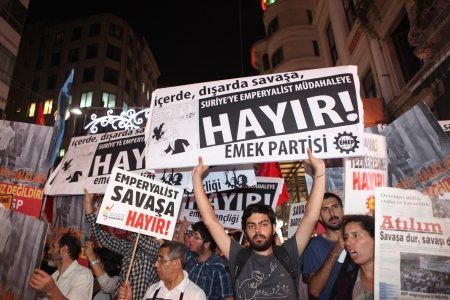 Demonstrators protest against the war with Syria inTaksim Square on October 4, 2012 in Istanbul, Turkey