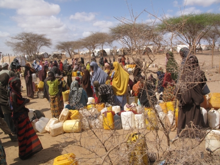 escaped: Dadaab, Somalia-August 15,2011: Woman & children live in the Dadaab refugee camp where thousands of Somalis wait for help because of hunger  in Dadaab, Somalia.