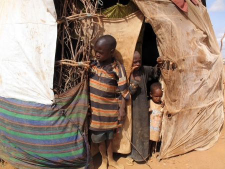 Dadaab, Somalia-August 15,2011: Woman & children live in the Dadaab refugee camp where thousands of Somalis wait for help because of hunger  in Dadaab, Somalia.