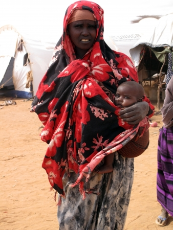 somalian: Dadaab, Somalia-August 15,2011: Woman & children live in the Dadaab refugee camp where thousands of Somalis wait for help because of hunger  in Dadaab, Somalia.