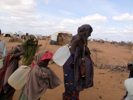 escaped:     Woman and children live in the Dadaab refugee camp where thousands of Somalis wait for help because of hunger  in Dadaab, Somalia.