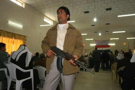 militant: KIRKUK, IRAQ-FEBRUARY 3: Unidentifield Arab militant regarding the safety in the Arabic Culture Center on February 3, 2007 in Kirkuk,Iraq Editorial