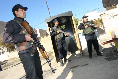 iraqi: KIRKUK, IRAQ - FEBRUARY 2: Iraqi soldiers stands guard on a check point on February 2, 2007 in Kirkuk, Iraq.