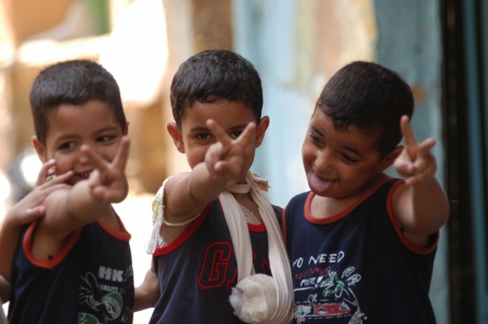 BEIRUT, LEBANON-AUGUST 2:Palestinian children make victory sign in Shatila refugee camp on August 2, 2006 in Beirut,Lebanon Editorial