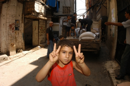 BEIRUT, LEBANON-AUGUST 2 Palestinian children make victory sign in Shatila refugee camp on August 2, 2006 in Beirut,Lebanon