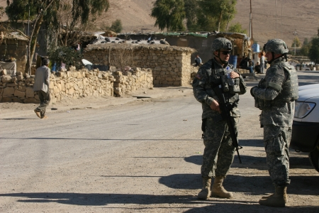 Maxmur, Iraq - January 26,2007: USA soldiers stands guard in a check point on January 26, 2007 in Maxmur, Iraq.