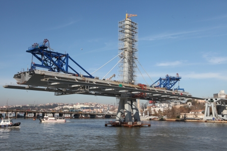 criticized: Istanbul,Turkey-December 26, 2012: The ongoing construction of the Golden Horn Metro Bridge has been criticized for breaking citys skyline on December 26, 2012 in Istanbul,Turkey