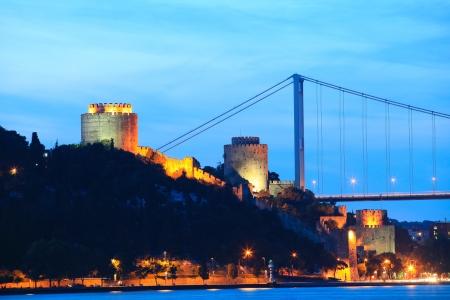 hisari: Fatih Sultan Mehmet Bridge and Rumeli Fortress at night in Istanbul,Turkey