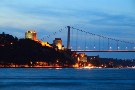 hisari: Fatih Sultan Mehmet Bridge and Rumeli Fortress at night in Istanbul,Turkey