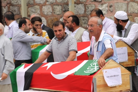 fatih: Istanbul-June 3, 2010:Tens of thousands gathered in Istanbul Thursday for prayers for activists killed in Israels deadly raid on aid ships bound for Gaza on June 3, 2010 in Istanbul, Turkey.
