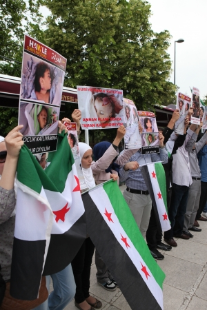 fatih: Istanbul, Turkey-May 29, 2012: A group of unidentified people stage a demonstration in front of the Fatih Mosque, protesting Syrian authorities violent crackdown in Homs, on May 29, 2012 in Istanbul,Turkey
