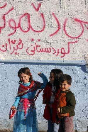 Kirkuk,Iraq-January 23, 2007: Arabic Children stands at the Wall,Kirkuk,Iraq.