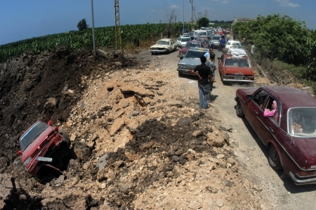 TYRE,LEBANON-JULY 31: Unidentified Civilians fleeing the Israeli bombardment on July 31, 2006 in Tyre,Lebanon